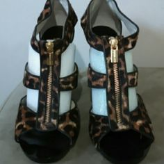 Michael Kors NWOT Leopard print, cut out heels, made of composed cow hair and leather, with zippered front. These have never been worn. I do not have the original box, but I assure you that they are in excellent condition. The numbers on the bottom of the shoes are a reflection of the original selling price. MICHAEL Michael Kors Shoes Heels