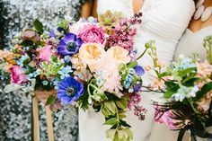 A bouquet of Blue Poppy anemones, peach garden roses, and fragrant lilacs