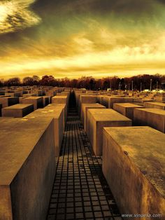 """Berlin, Germany: Home of the Berlin Wall and loads of history. This modern city is liberal urban setting in a more conservative country. """"What are they doing/wearing?"""" """"WHO CARES IT'S BERLIN"""" We loved it here. (photo is of a Jewish memorial. We went through at night... Eerie)"""