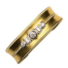Yellow gold and diamond bracelet | From a unique collection of vintage cuff bracelets at http://www.1stdibs.com/jewelry/bracelets/cuff-bracelets/