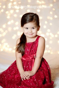 The theme for this years Christmas mini sessions: Christmas Light Photographs!  The twinkle of the white lights was the perfect background for these holiday cuties, don't you think
