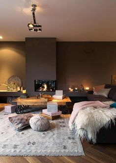 Warm and cozy living room in dark colors and a fireplace