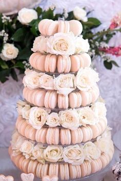 A dreamy macaron tower to center your dessert table at your summer wedding reception. Wedding Desserts, Wedding Decorations, Wedding Dessert Buffet, Bridal Shower Table Decorations, High Tea Decorations, Diy Quinceanera Decorations, Sweet Sixteen Decorations, Pink Dessert Tables, Bridal Table