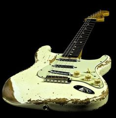 "This white (more unusual color, by the way) ""Slightly Used"" Fender Stratocaster obviously has brought a guitarist many hours and years of joy in music! -DdO:)"