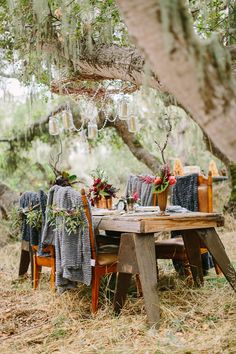 bohemian wedding table - photo by Danielle Poff Photography http://ruffledblog.com/best-of-2014-receptions #weddingideas #receptions