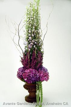Stunning urn design featuring delphinium, heather, hydrangea, amaranthus and willow