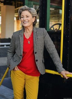 red shirt, mustard pants, hound's tooth jacket