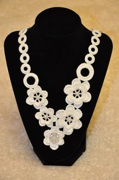 """This gorgeous crocheted necklace is made from 100% fine cotton thread. Necklace with fastenings (spring ring clasp and metal ring) measures approximately 23 inches around a neck. Diameter of the largest ring: 1"""" Hand wash gently in cold water. DO NOT machine wash. Lay flat to dry."""