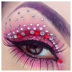 Sparkly pink eye shadow accented with statement eye lashes and clear & red jewels by 'Stacey'.