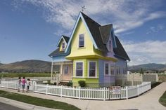 Carl and Ellie's house from the movie 'Up' is now an actual home ready to be moved into. The house was built by Bangerter Homes in the city of Herriman, Utah. The cost of the home is $390,000. Throughout the home you will find that it is true to the movie; it even has the same mailbox. The basement does feature a home theater and two bedrooms. The basement bedrooms are decorated in Disney Princess and 'Toy Story' motifs.