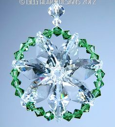 STAR OF LIFE IN SWAROVSKI CRYSTAL CLEAR EARTH GREEN BI CONE BEADS THIS IS ANOTHER LILLI HEART DESIGNS MY ORIGINAL DESIGN AN OCTAGON STAR