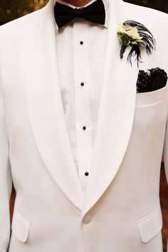 White tuxedo, black tie.
