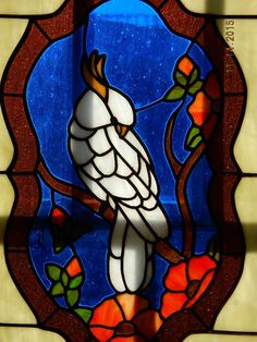 Howdy ..  Dad made this awesome piece of glass art a few years back. What a gift for a bird lover ! Measures 21 by 17 inches and is ready to hang in a wood frame with chain. The lines behind the glass are our window frames.. not the glass work !  Thanks and have a good one .. Dakota Gypsy