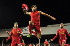 Liverpool's English midfielder Steven Gerrard (C) celebrates scoring their third goal during the English Premier League football match between Fulham and Liverpool at Craven Cottage in London on February 12, 2014