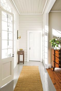 Paint the kitchen subfloor (if it is plank) with porch paint. The Foyer - Home Sweet Homestead - Southern Living. Country Farmhouse Decor, White Farmhouse, Farmhouse Chic, Farmhouse Design, Farmhouse Ideas, Bill Ingram, Porch Paint, Foyer Decorating, Entry Foyer