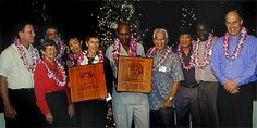 2000 Hall of Fame Ceremony. Pictured on stage from left to right are: Dr. Jim Barahal, president, Edith Leiby and Jack Scaff, 1996 inductees, Jeanette Chun, 1998 inductee, Carla Beuskens, 2000 inductee, Filbert Bayi (for Simon Robert Naali, 2000 inductee), Tommy Kono, 1999 inductee, Ronald Chun, 1998 inductee, Mbarak Hussein (for bother Ibrahim Hussein, 1997 inductee), and Dr. Jon Cross, race director.