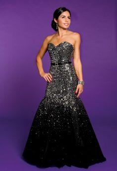 Do you want to look like a Hollywood Celebrity?  This dress is inspired by the Academy Awards.  It has all over sequins from top to 3/4 of the bottom, trumpet cut tulle and has a fabulous belt-like waistband held together with a rhinestone buckle.You will be the bell of the ball wearing this as a Prom Dress.