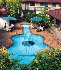 Legend has it that this building is right across the street from Country Music Hall of Fame, so the owner at that time thought it would be a good idea to build a pool that was shaped like a guitar in order to attract tourist to come and visit.