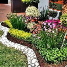 Not the specific plants I would choose for the front yard, but the layout is int. Front Yard Garden Design, Front Garden Landscape, Small Front Yard Landscaping, Rock Garden Design, Garden Yard Ideas, Backyard Garden Design, Garden Projects, Garden Landscaping, Landscaping Design