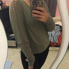 Oversized long sleeve Thin and kind of shear, looks great with bralettes! Flowy and comfortable/light weight and stretchy. Light green/olive color. Foreign Exchange Tops