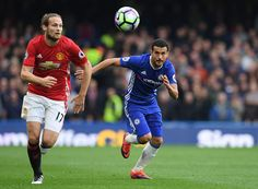 Pedro of Chelsea chases down Daley Blind of Manchester United during the Premier League match between Chelsea and Manchester United at Stamford...
