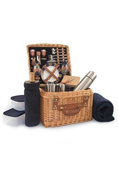A vintage-inspired picnic basket is fully furnished with service for two, including everything from hand-blown wine glasses and stainless-steel coffee mugs to a soft fleece picnic blanket.