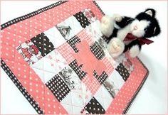 Create the Big Sister Dolly Quilt using different colored, itty bitty squares.