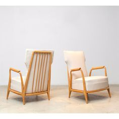 A rare pair of vintage low armchairs in solid Caviúna wood by Giuseppe Scapinelli