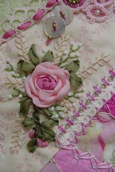 Just lovely - ribbon rose embroidery, love the accents, ribbot woven through crochet, stitching, buttons, pearls, etc.