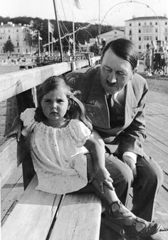 He seemed to have liked little girls, but they never looked happy with him.   Hitler with Helga Goebbels, daughter of Reichspropagandaministers Joseph Goebbels. Photograph from appr. 1935.