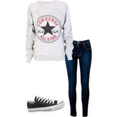 White long sleeve shirt w/ converse logo on front; dark navy skinny jeans; black ankle high converse shoe