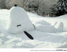 Snoopy snow sculpture - would be twice as awesome as an igloo or fort!