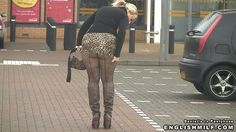 Sexy blonde adjusting her leopard print mini skirt wearing seamed fishnet tights and boots in public. Daniella in pantyhose videos.