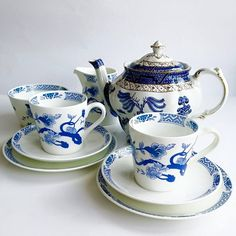 Teacup trios and creamer by Tuscan--Teapot by Booth's