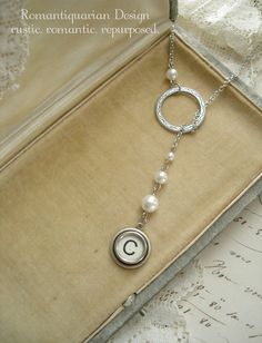 Typewriter Key Jewelry - Letter C Vintage Typewriter Key Necklace. Antique Silver Lariat Necklace with White Pearls. Initial Jewelry.. $48.50, via Etsy.