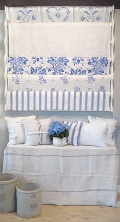 "I love everything about this picture. Linens, pillows, crocks.    Exclusive linen fabric by Swedish Designer Ingela Westergaard. Handprinted in Dalarna, Sweden.    In picture, from top to bottom:""Tulips and Hearts"" Blue/White; ""Tulips and Hearts"" White/White; ""Roskulla"" Blue/Lavender; ""Porslinsros"" Blue/White; ""Lagerrand"" Blue/white."