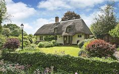 Old Hills, Worcestershire /     This chocolate-box, thatched cottage ot Old Hills, near Malvern, has origins stretching back to 1580, plus handsome slate flooring and four bedrooms.