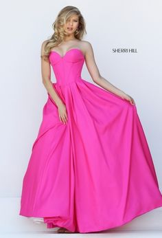 Turn heads in this hot pink taffeta pageant or prom dress by Sherri Hills. Features an a-line skirt and a sweetheart neckline.