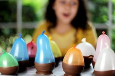 Balloon Bowls. Dip small balloons into melted milk choc., harden, pop balloon and peel away, Fill with ice cream  #