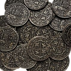 The Pieces of Eight glinted with the dull sheen that only real real gold possess....
