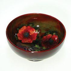 Humler & Nolan | December 2010   Moorcroft poppy bowl with rich flambe' glaze. Made in England