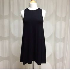 Black Sleeveless Swing Dress This amazing piece can be dressed up with heels and statement necklace or worn with sandals and a jean jacket for casual play! It's the perfect travel dress! Made in the USA. 96% Rayon, 4% Spandex NO TRADES  April Spirit Dresses Mini