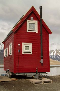 Check out this Tiny Red Cottage on Wheels in Longyearbyen, Svalbard. It's a mobile tiny home!