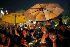 TIANANMAN-ANNIVERSARY/HONGKONG Pro-democracy supporters hold yellow umbrellas, a symbol of the Occupy Central movement, during an annual candlelight vigil at Victoria Park in Hong Kong, China June 4, 2015. Tens of thousands attended the vigil in Hong Kong on Thursday to mark China's 1989 crackdown on pro-democracy demonstrators in Beijing, an anniversary given added poignancy by protests that gripped the Chinese-run city last year. REUTERS/Bobby Yip