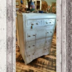 Distressed light blue waterfall chest of drawers. $124.99