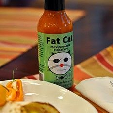 Fat Cat Mexican Style Habanero Hot Sauce While the orange habanero is one of the world's hottest chilies, this sauce takes a decidedly Mexican approach to it, focusing more on the pepper's fruity flavor than its intense heat. Don't get this wrong: This is still darned hot stuff, but it's also savory and sweet.