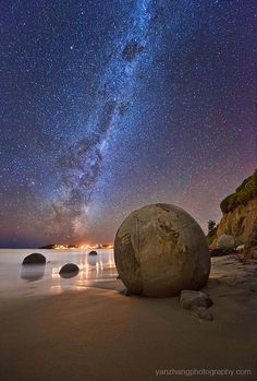Beautiful milky way over the Moeraki Boulders, New Zealand. They are unusually large and spherical boulders lying along a stretch of Koekohe Beach on the wave cut Otago coast of the South Island of New Zealand between Moeraki and Hampden. (by Yan Zhang on Places To Travel, Places To See, Travel Destinations, Beautiful World, Beautiful Places, Beautiful Pictures, Moeraki Boulders, Ciel Nocturne, South Island