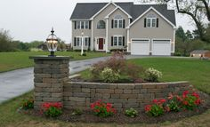 This Rumbled™ Wall with a lantern adds some great curb appeal!