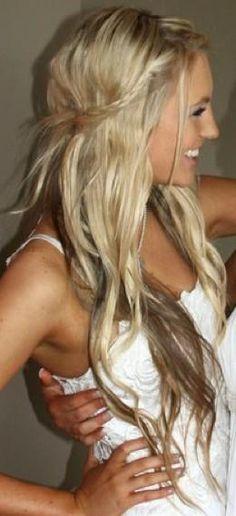 Gorgeous long hair for a beach wedding. Simple little braided detail.
