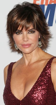 Lisa Rinna   I am resigned; going to stick with this cut.  My hair has a mind of its own when it comes to flipping on the ends